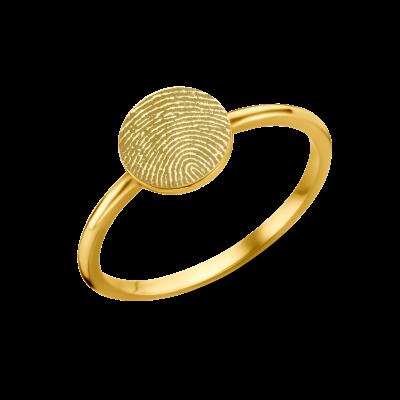 Gouden zegelring met vingerafdruk