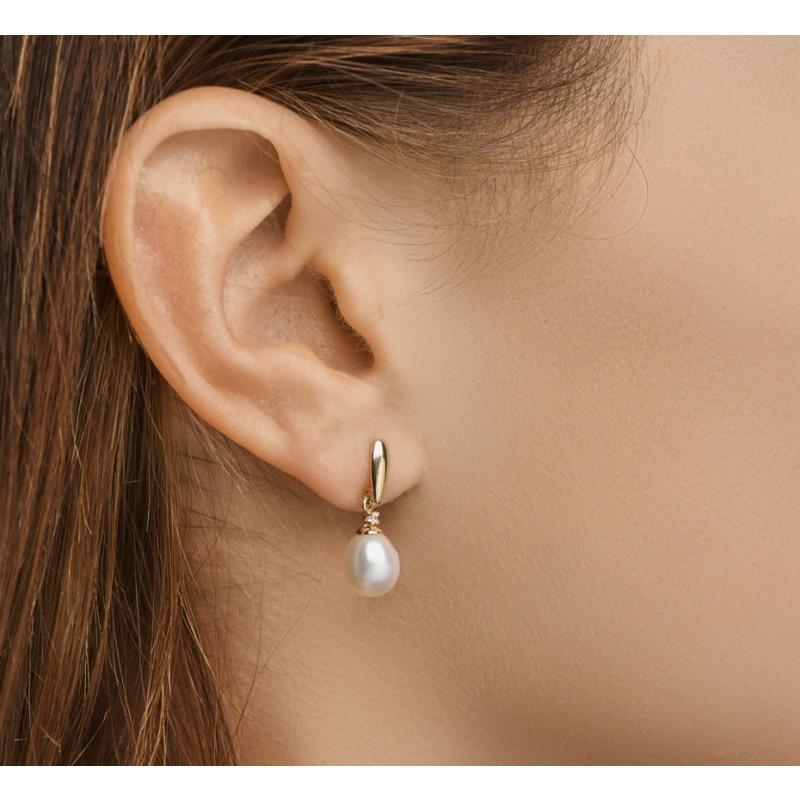 Gouden parel oorbellen met zirkonia